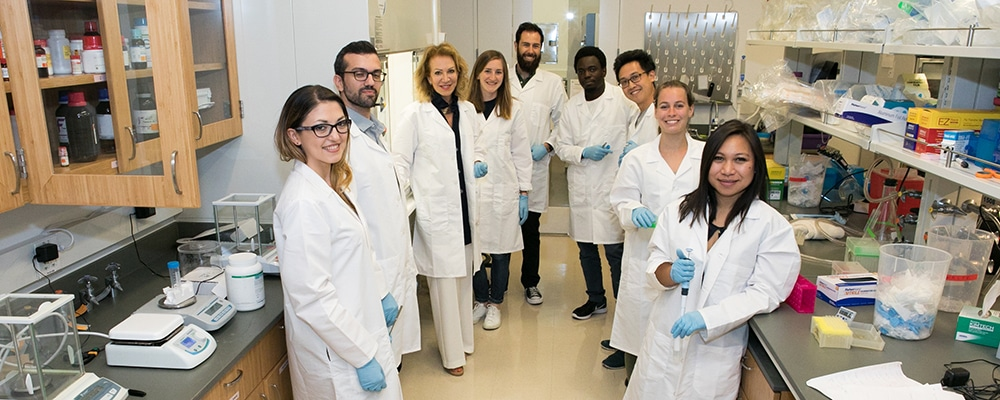 Neuroscience Initiative Director Patrizia Casaccia with faculty and students in a neuroscience lab at the ASRC