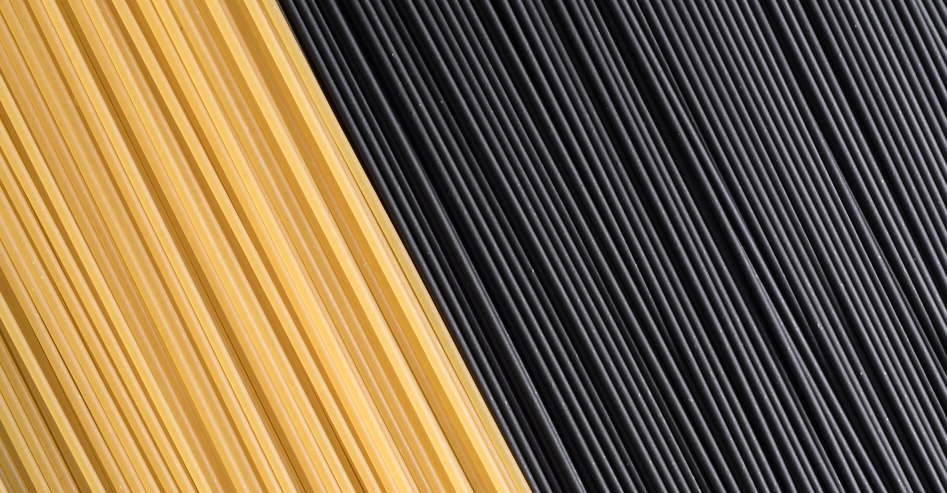 Uncooked Squid ink Spaghetti and Yellow Spaghetti Full Frame Shot, Directly Above View.