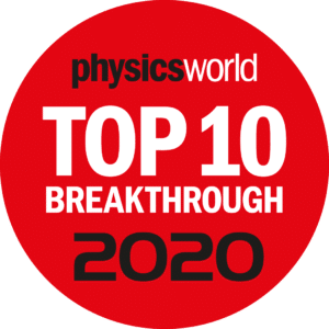 "White and black text on a red circular background reading ""physics world top 10 breakthrough 2020"""