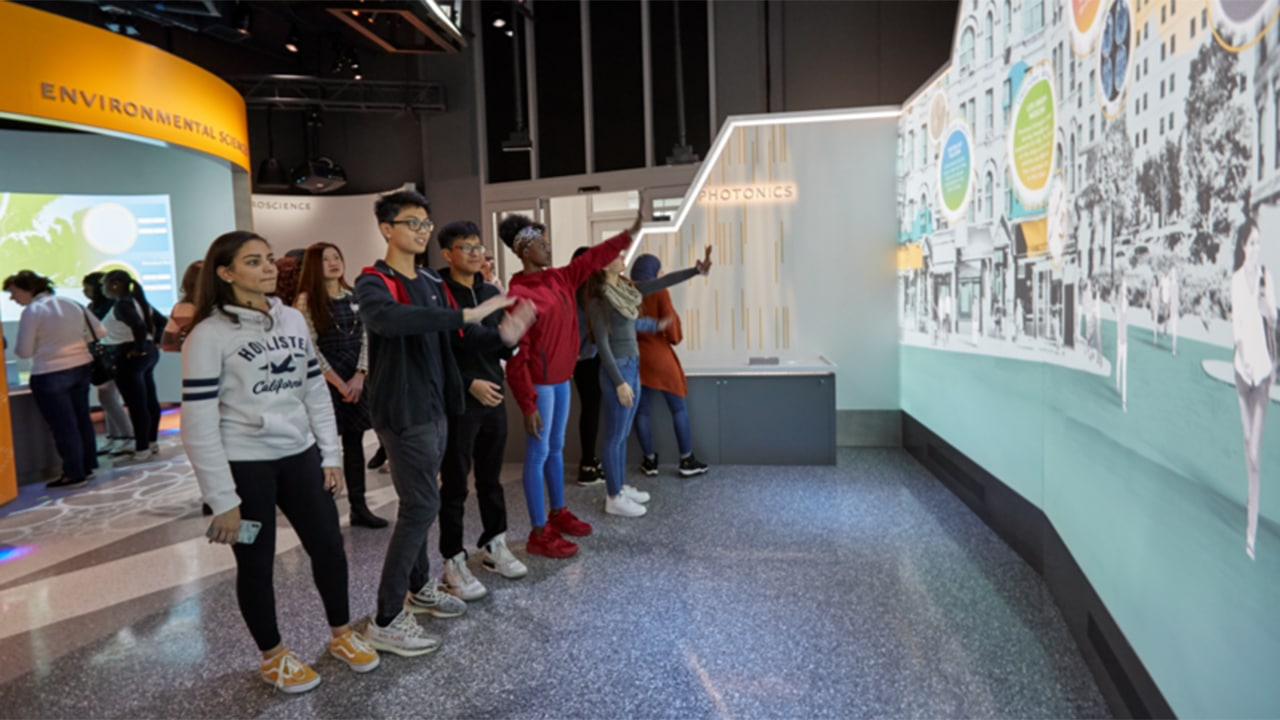 high school students interacting with the digital wall in the ASRC Illumination Space