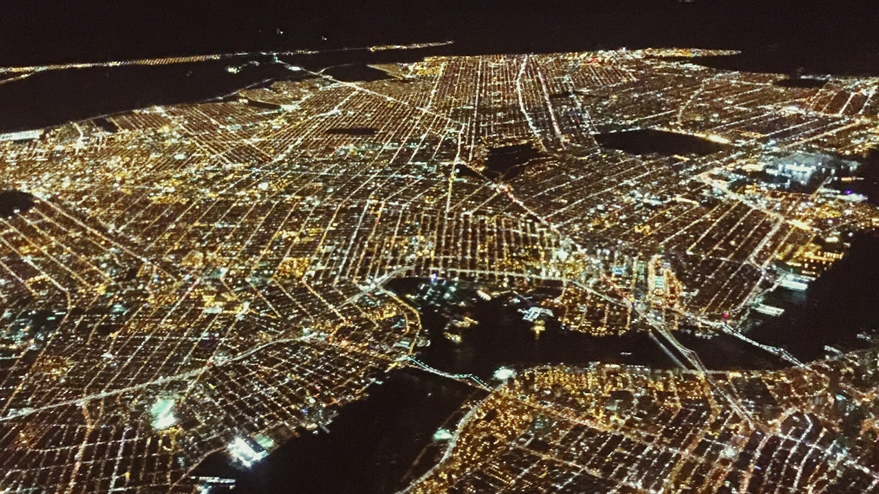 aerial image of a a lit city at night