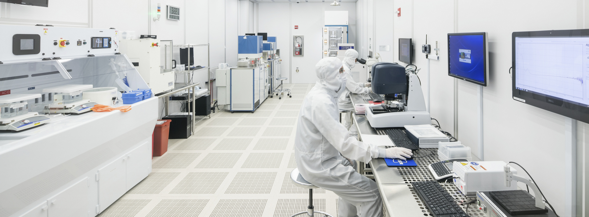 researcher in a nanoscience lab wearing cleanroom gear