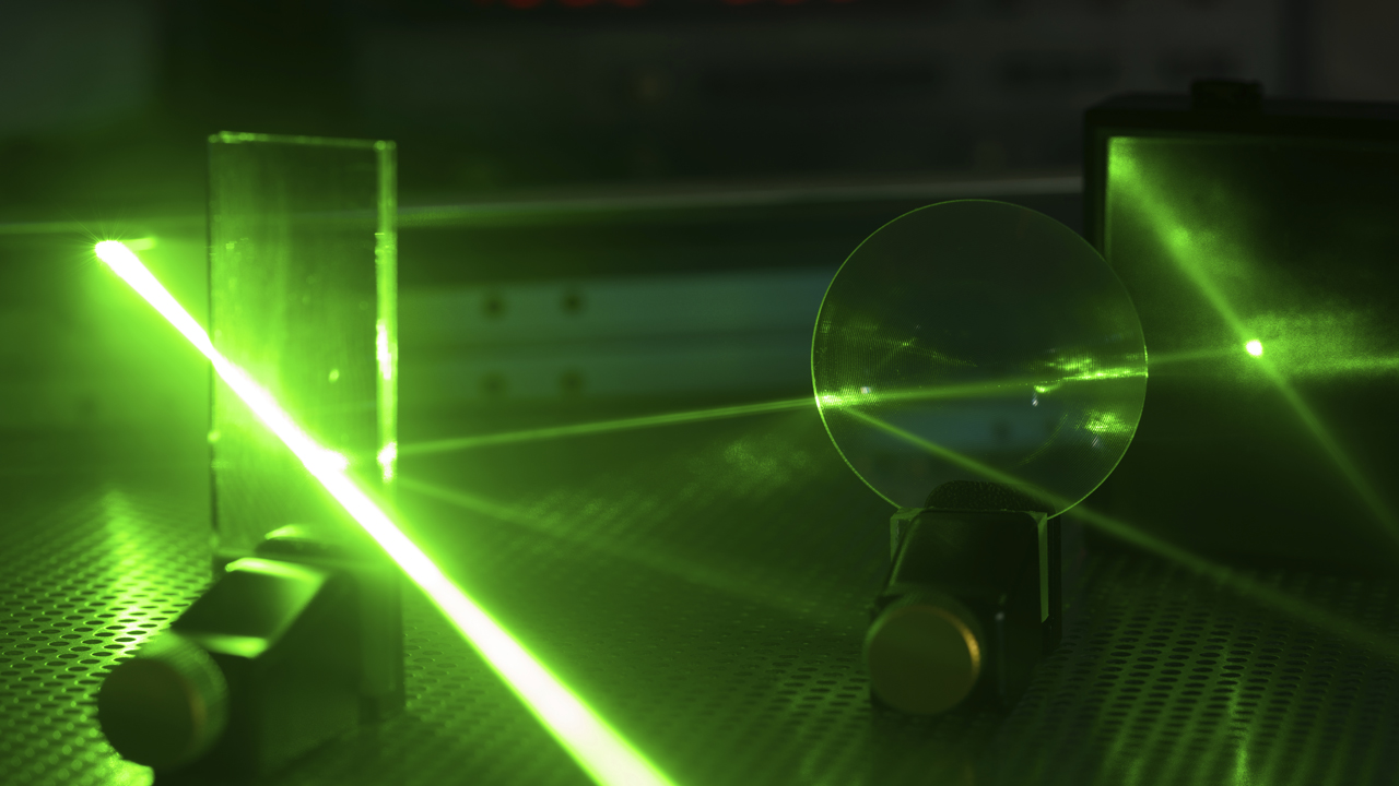 Laser experiment in photonics laboratory.